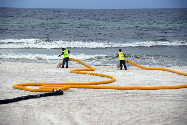 Hass Hydro Excavation Services vacuuming beach after oil spill